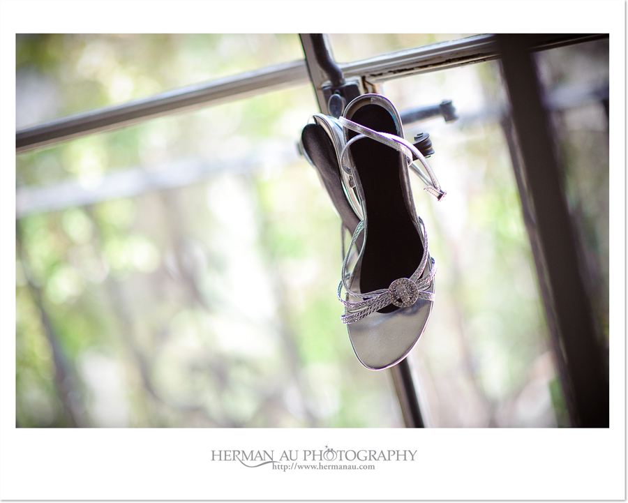 bridal shoes hanging off the window