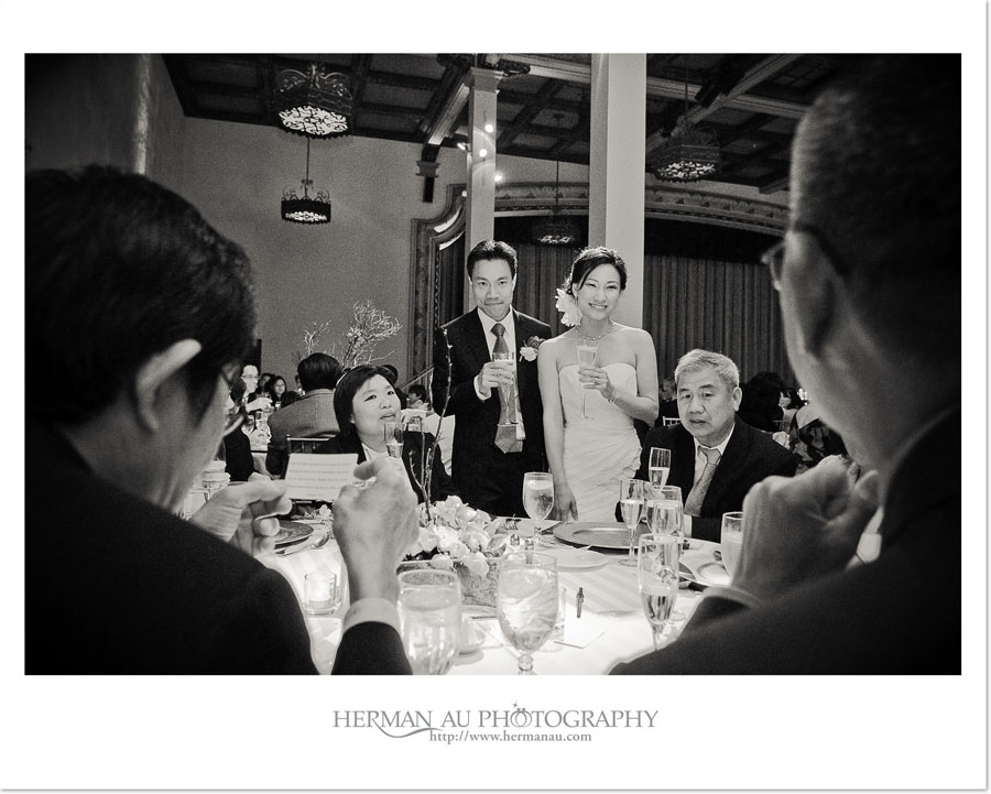 bride and groom's table toast