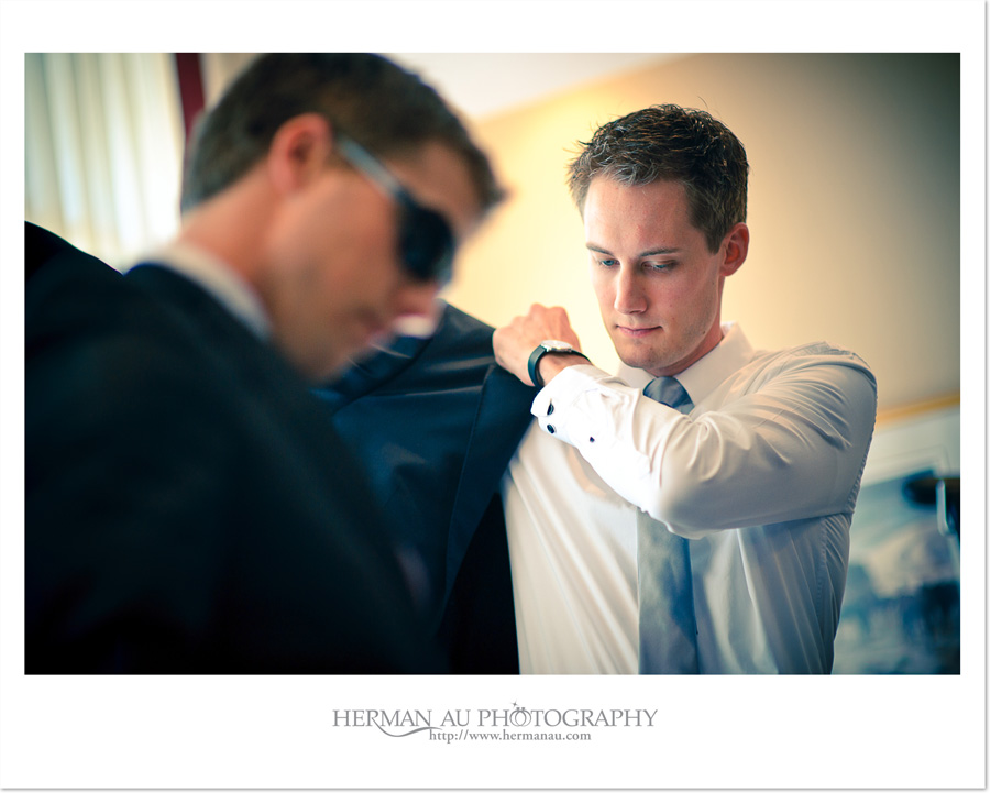 groom putting on jacket photojournalism capture