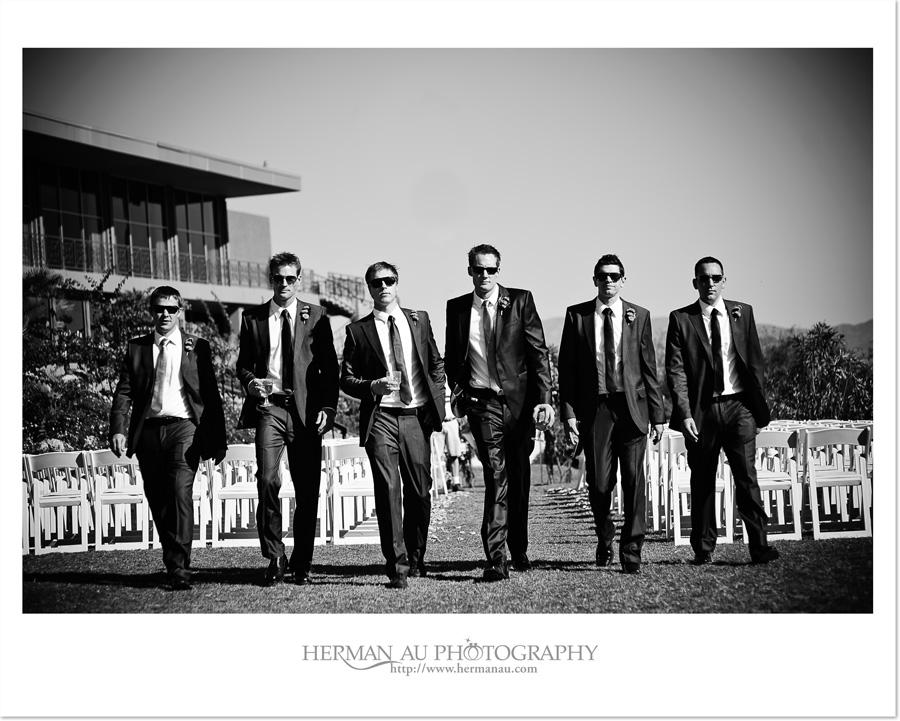 modern groom and groomsmen walking portrait