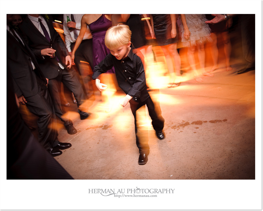 little boy dancing at the wedding reception