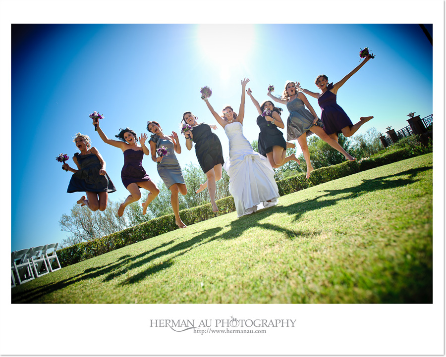 contemporary bride and bridesmaids jumping portrait