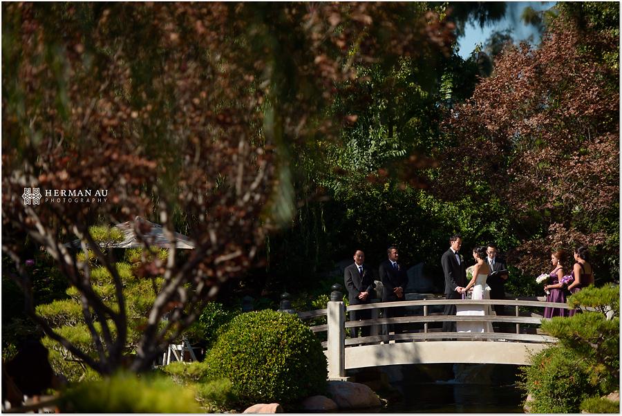 Muoy & Dave wedding ceremony on japanese garden bridge