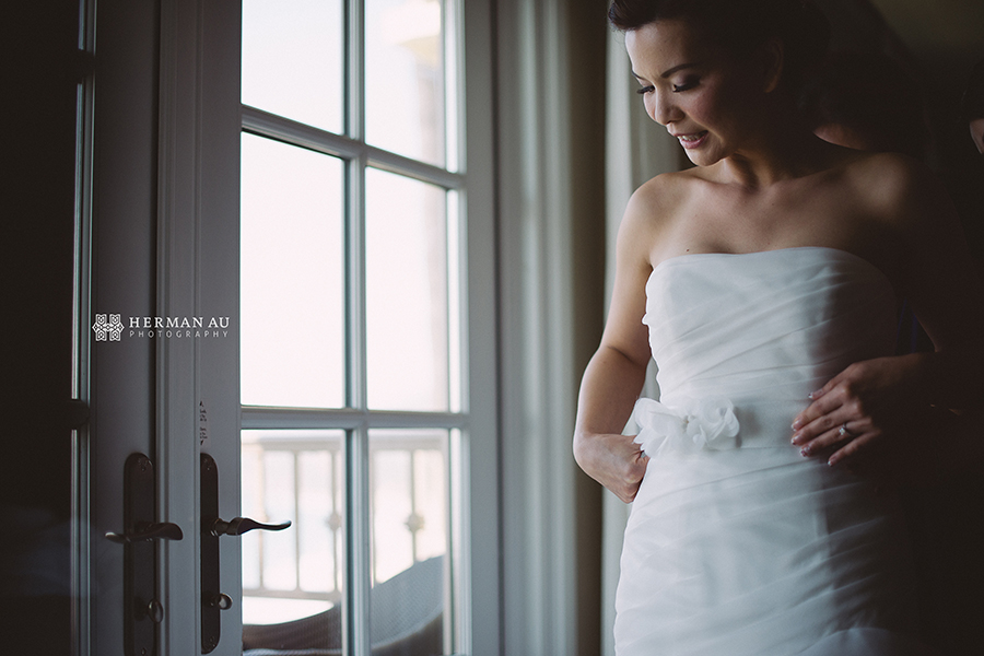 Lammy & Ken Ritz Carlton Laguna Niguel wedding putting on wedding gown 2