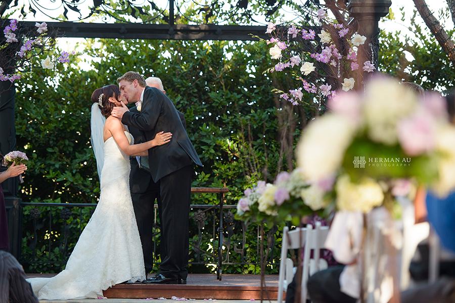 17.Padua Hills Theatre wedding first kiss