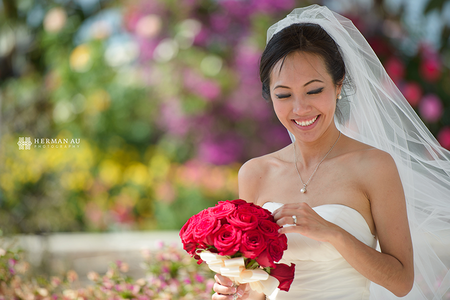 28.Bride in front of flowers portrait